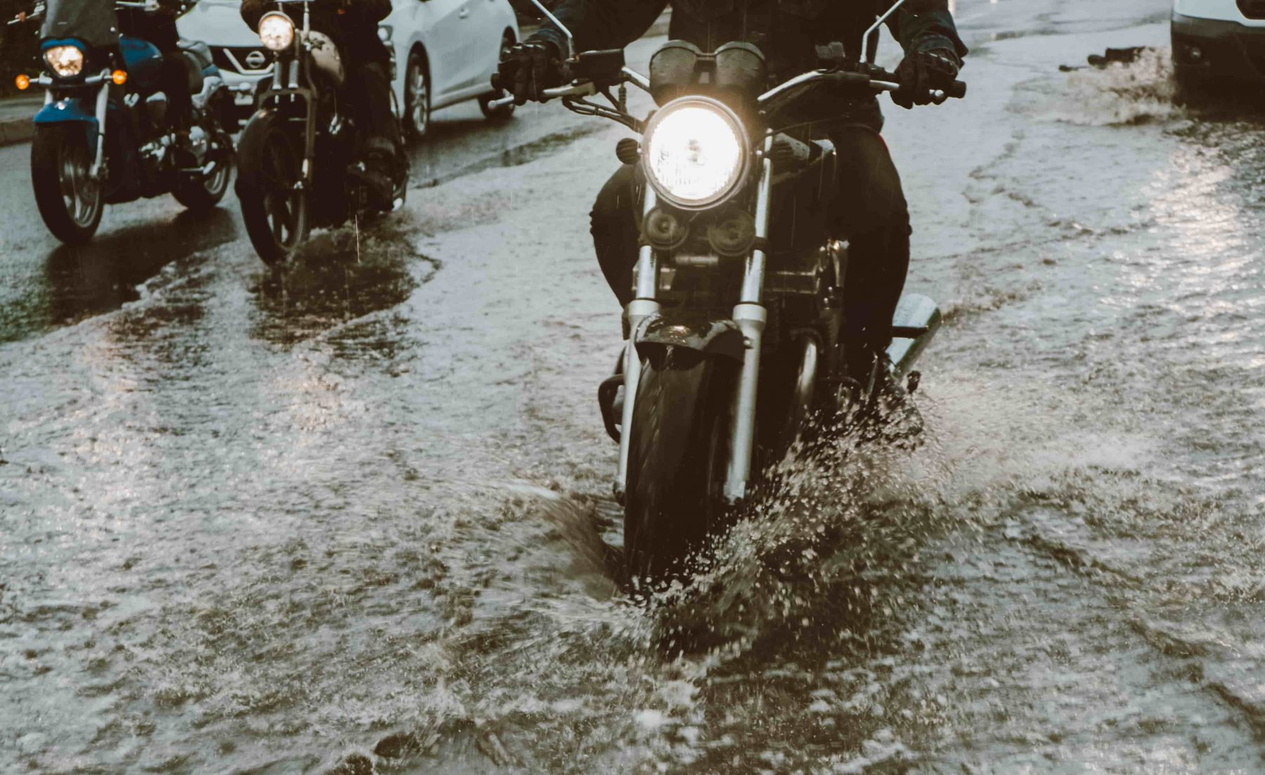 motorcycle moving in flood